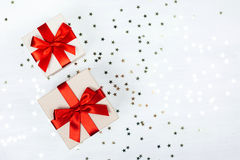 Two presents with red bow. On white wooden rustic surface. Festive picture made in flat lay style with place for text Royalty Free Stock Photography