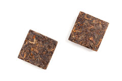 Two pressing briquette of black Chinese Pu Erh tea Royalty Free Stock Photos