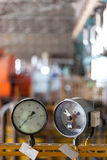 Two pressure sensors. Inside factory. Selective focus Stock Photography