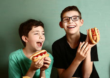 Two preteen boys with hot dog close up Stock Photo
