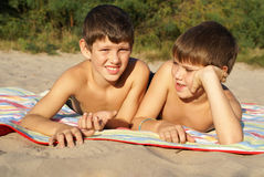 Two preteen boys outdoors. Two preteen boys sunbathing on beach Stock Photography