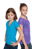 Two preteen girls against the white Stock Image