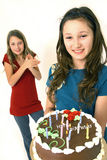 Two preteens with birthday cake. Two preteens with chocolate birthday cake in hands Stock Photography