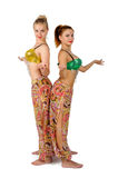 Two pretty belly dancers over white Royalty Free Stock Images