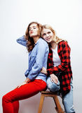 Two pretty blond woman having fun together on white background, mature mother and young teenage daughter, lifestyle Royalty Free Stock Photography