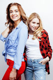 Two pretty blond woman having fun together on white background, mature mother and young teenage daughter, lifestyle Stock Photography