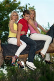 Two pretty blonde and young man Stock Photos