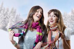 Two pretty brunette girls having fun in winter Royalty Free Stock Photos