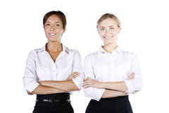 Two pretty business woman smiling at camera Stock Image