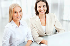 Two pretty business women Stock Images