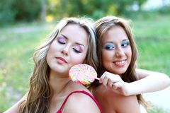 Two pretty caucasian girls with lollipop Royalty Free Stock Photo