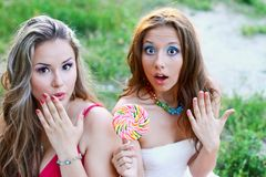 Two pretty caucasian girls surprised Stock Photos
