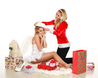 Two pretty christmas girl try on a Santa hat Stock Photography
