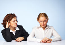 Two pretty confident business women. Pretty confident business women against light background Stock Images