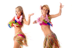 Two pretty dancers in hawaiian costumes Royalty Free Stock Images