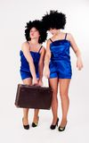 Two pretty dancers with old suitcase Royalty Free Stock Image