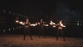 Fireshow performers juggling staves on riverside stock footage
