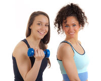 Two pretty fitness girls exercising with smile Stock Images