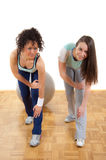 Two pretty fitness girls exercising together Royalty Free Stock Photography