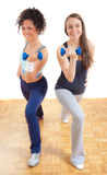 Two pretty fitness girls exercising together Stock Photos
