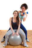 Two pretty fitness girls with weights and ball Stock Image