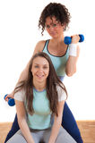 Two pretty fitness girls with weights, smiling Royalty Free Stock Photos