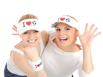 Two pretty football fan girls in funny hats. Isolated on white background Royalty Free Stock Photo