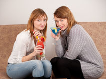 Two pretty friends celebrating Stock Image