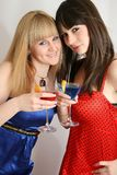 Two pretty friends with cocktail. Two pretty friends celebrating, isolated Stock Image
