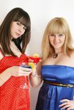 Two pretty friends with cocktail Royalty Free Stock Images