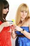 Two pretty friends with cocktail Stock Images