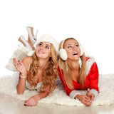 Two pretty girl in Christmas dresses celebrating Royalty Free Stock Image
