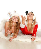Two pretty girl-friends in Christmas dresses Stock Photo