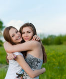 Two pretty Girl Friends Laughing  in spring or summer outdoors Royalty Free Stock Photos