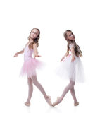 Two pretty girlfriends-ballerinas posing at camera Stock Photos