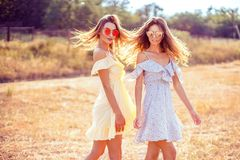 Free Two Pretty Girlfriends In Summer Dresses Royalty Free Stock Photography - 125961527