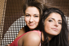 Two pretty girlfriends at party dancing smiling close up, fancy fashion dresses Stock Photos