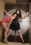 Two pretty girlfriends at party dancing smiling close up, fancy fashion dresses Royalty Free Stock Photography