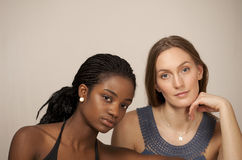Two pretty girls. Face portrait in horizontal with copy space Royalty Free Stock Photography
