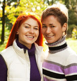 Two pretty girls in autumn park Stock Photos