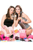 Two pretty girls blow bubbles. Isolated Royalty Free Stock Images