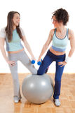 Two pretty girls fitness exercising Royalty Free Stock Photography