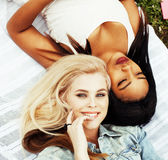 Two pretty girls on grass happy smiling, best friends having fun together, lifestyle people concept. Close up Royalty Free Stock Photography