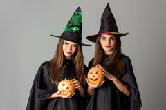 Two pretty girls in halloween style Stock Photos