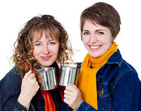 Two pretty girls having coffee Stock Images