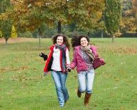 Two pretty girls having fun. In autumn park Stock Photo