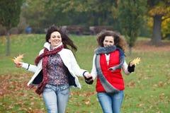 Two pretty girls having fun Royalty Free Stock Image