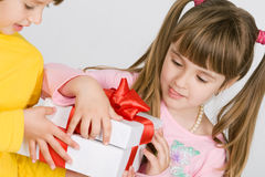 Two pretty girls holding gift box Stock Photo