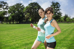 Two pretty girls jogging Stock Image