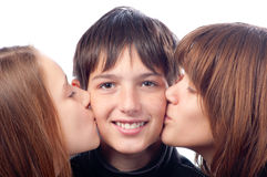 Two pretty girls kissing smiling boy Royalty Free Stock Photos